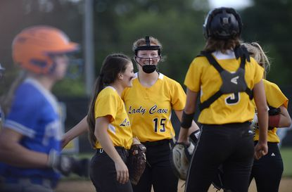 South Carroll pitcher Maddie Karns celebrates with teammates after striking out the final batter in their 15-6 win over Sparrows Point in Winfield Tuesday, June 15, 2021.