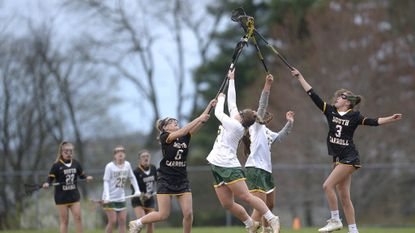South Carroll's Paige Abbott and Riley Evans battle Century's Grace Bruce and Demma Hall for the draw in the first half of the Cavaliers' 9-7 win over Century in Eldersburg Tuesday, April 17, 2018.