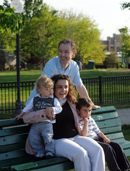 "The Children's Choice Learning Center, housed in the Social Security Administration building on North Greene Street, is slated to close this year. ""My son is so happy there, I want to keep him there,"" said Celine Plachez, shown with her husband, Stephan Vigues, and their two sons, Bastien Vigues, 1, and Pierre Vigues. ""The best thing for everybody is to keep the center open."""