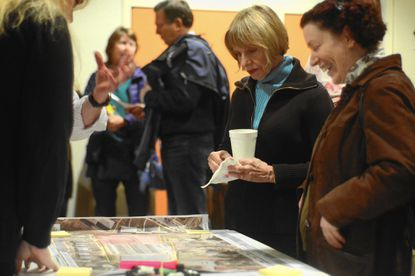 Florence Newman, center, looks at a map of a proposed 2.36 acre park in Aigburth Manor during a public forum Monday on the facility. Newman lives near the proposed park, which would be built on property owned by Radebaugh Florist & Greenhouses.