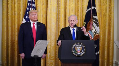 President Donald Trump and Israeli Prime Minister Benjamin Netanyahu take part in an announcement of Trump's Middle East peace plan in the East Room of the White House.