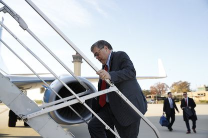 Attorney General William Barr boards a government aircraft on Nov. 21, 2019, at Andrews Air Force Base.