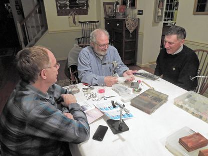 Joe Bruce demonstrates tying his Articulated Bullethead Darter while Steve Rehner (left) and Rick Lower (right) observe.