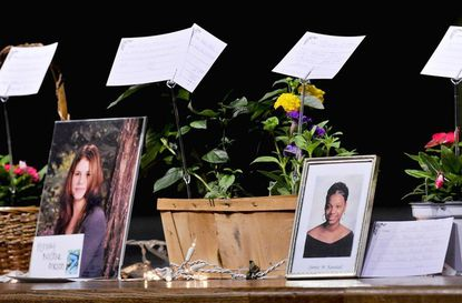 Ashley Nicole Mason, left, and Jamie Randall, in photo at right, were two of the victims represented with notes written by survivors on display along the edge of the stage at the 23rd annual Memorial Service for Crime Victims and their families at Long Reach High School.