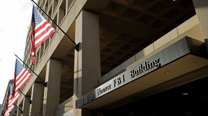 United States flags hang in front of the Federal Bureau of Investigation Edgar J. Hoover Building May 9, 2017 in Washington, DC.