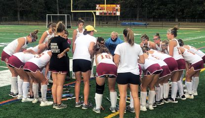 The Hereford field hockey team huddles together prior to its game against Dulaney on Wednesday, Oct. 2.