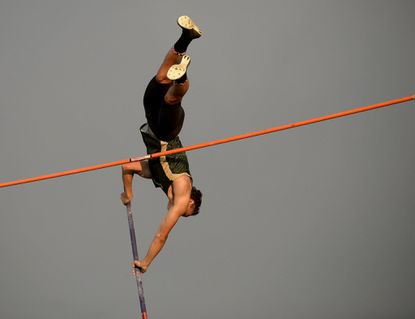 """Century's Kyle Bryant clears 13'9"""" to win the pole vault during the 2A West Regional Track and Field Championships in Eldersburg Thursday, May 18, 2017."""