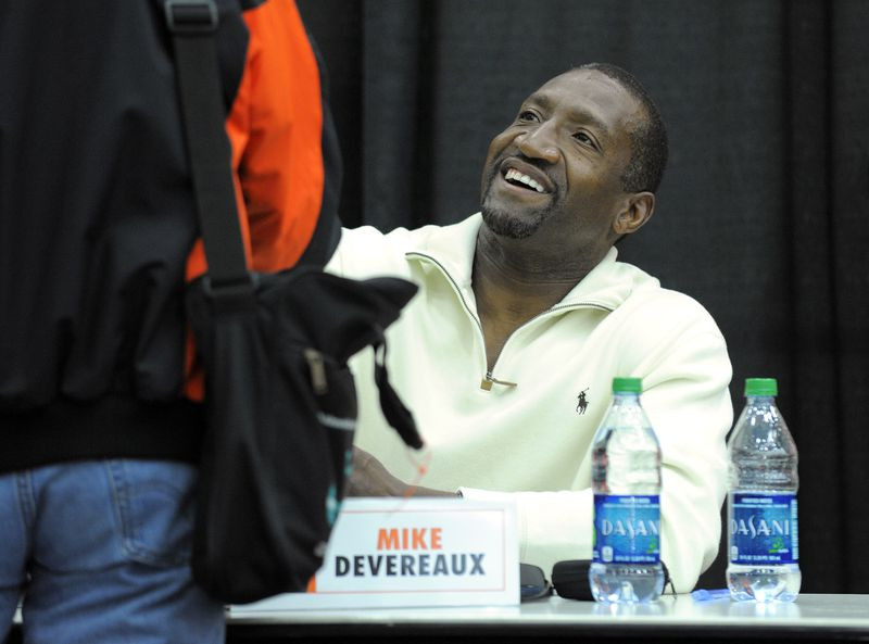 Former Oriole Mike Devereaux signs autographs at Orioles FanFest in 2018.