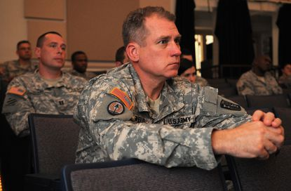 Col. John B. Wells, commander of the U.S. Army Claims Service at Fort Meade, listens to mandatory suicide prevention training in the Post Theater on base.