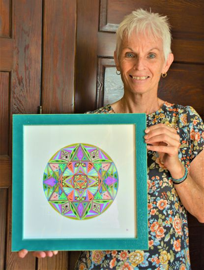 "Patricia Lappin is pictured with her art titled ""Grounding."""