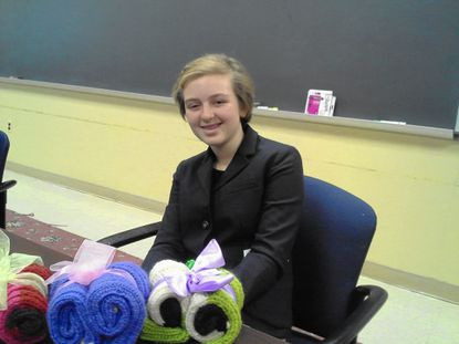 Lily DeBell, an eighth grader at Roland Park Elementary School, shows some pairs of her Lily's Legwarmers. Lily is the winner of a national contest for student entrepreneurs.