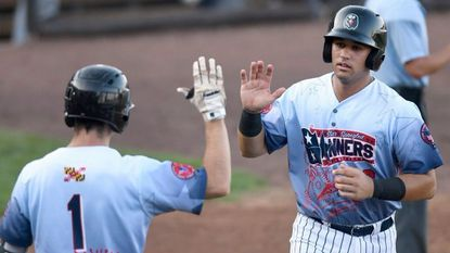 J.C. Escarra, right, shown high-fiving teammate Adam Hall in a recent game, was named MVP of the Aberdeen IronBirds last week for his play during the 2018 season