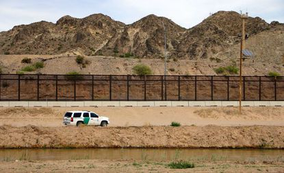A U.S. Border Patrol is seen from Mexico while patrolling along the border line between the cities of El Paso, Texas and Ciudad Juarez in Mexico last April.