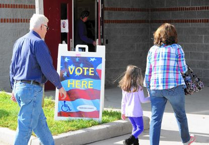 Voters head in to Forest Lakes Elementary School to cast their ballot during Tuesday's general election.