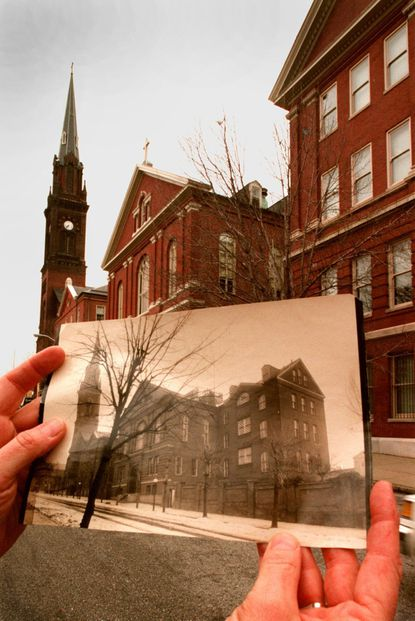In this Dec. 19, 1996 photo, The Institute of Notre Dame is juxtaposed with a photograph from the early 1900s in Baltimore. Catholic schools and other private schools are facing tough financial times amid economic fallout from the coronavirus pandemic. The school, founded in 1847, closed last month. House Speaker Nancy Pelosi is an alumna.