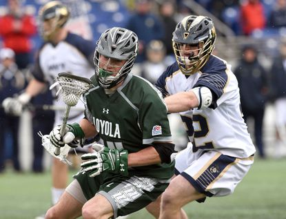 Loyola's Jared Mintzlaff moves the ball against Navy.