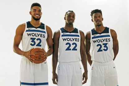 The Timberwolves' Andrew Wiggins, Karl-Anthony Towns and Jimmy Butler pose at media day on Sept. 22, 2017.