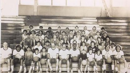 Paul Baker (in the middle of front row with the mustache) at Wheeling College's basketball camp. John Beilein is in the front row on the far right.