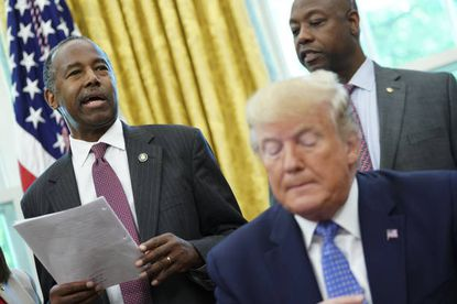 Ben Carson, Secretary of Housing and Urban Development, left, and President Donald Trump in the Oval Office in June 2019.