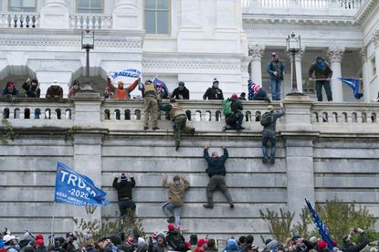 In this Jan. 6, 2021 file photo, supporters of then President Donald Trump climb the west wall of the the U.S. Capitol in Washington, D.C. (AP Photo/Jose Luis Magana, File)
