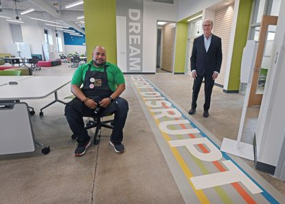 Larry Rivitz, right, co-founder and co-chair of charter school Green Street Academy, and the school's director of innovation, Harry Preston, are pictured at the school's new learning space, the Elijah E. Cummings Innovation Center.