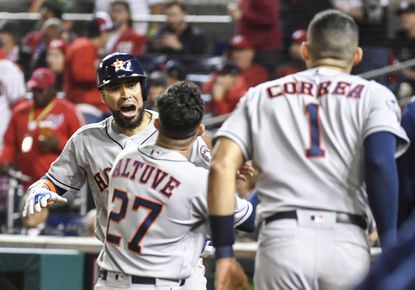 Astros catcher Robinson Chirinos, back left, celebrates with teammates after a sixth-inning home run during Game 3 of the World Series between Houston and the Washington Nationals at Nationals Park on Friday night. MUST CREDIT: Washington Post photo by Katherine Frey