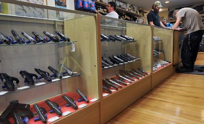 Pasadena Pawn and Gun store has seen an increased demand for handguns and with that more background check applications to fill out. File.