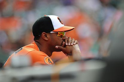 Baltimore Orioles' Henry Urrutia watches from the dugout against the Chicago White Sox in a baseball game, Saturday. On Sunday, Urrutia was named the organization's top minor league position player of the year.