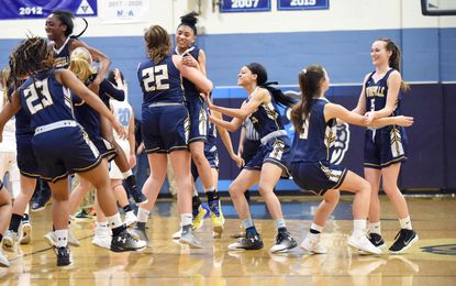 Catonsville teammates celebrate on the court following a 2018 win over Howard during the playoffs. The Comets eventually reached the state championship game which they lost to Eleanor Roosevelt.