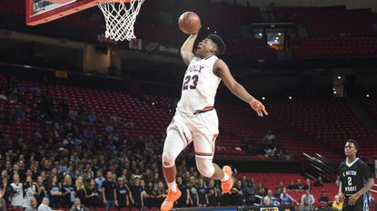 Poly's Brandon Murray goes up for a dunk after a turnover by C. Milton Wright during the MPSSAA Class 3A boys basketball semifinal game at the University of Maryland on Thursday.