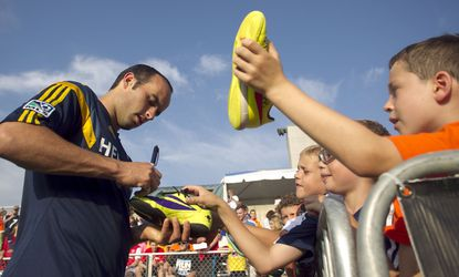 Landon Donovan signs autographs for fans before a U.S. Open Cup match against the Carolina Railhawks on June 24.