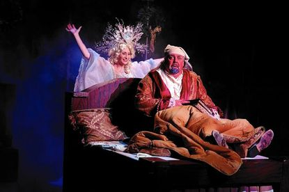 """""""A Christmas Carol"""" at Toby's in Columbia with Annapolis resident David Reynolds as Scrooge and Heather Beck as the Ghost of Christmas Past."""