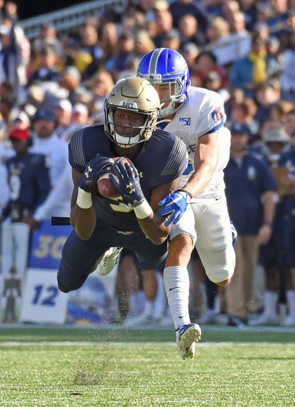 Sophomore Mychal Cooper, shown making an acrobatic catch against Air Force, led Navy in receiving in 2019.