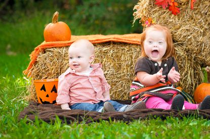 Ava McKelvey, right, and her baby brother Michael pose for a fall photo last October.The image will appear in NYC's Times Square to kick off Down Syndrome Awareness month.