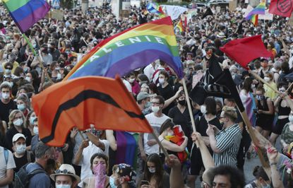 LGBT rights supporters protest against rising homophobia in Warsaw, Poland on Aug. 8, 2020.