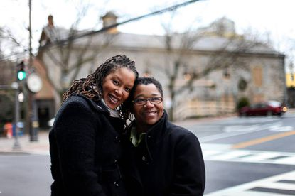 Deborah Cummings-Thomas, left, and Sheila Alexander-Reid, right, both of Ellicott City pose for a photo on Main Street in Ellicott City. They are the first couple to receive a same sex marriage license in Howard County.