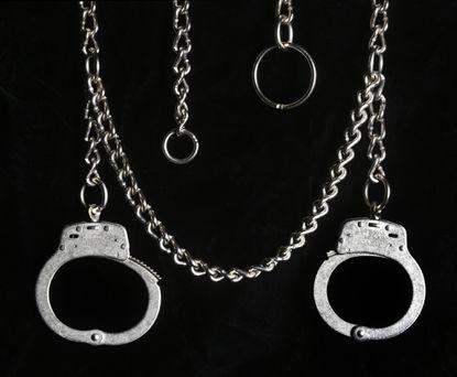 Hand shackles, which attach to a waist belt chain.
