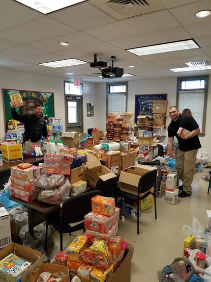 The Taneytown Police Department collects nonperishable food for the Stuff the Police Car fundraiser, pictured in 2018.