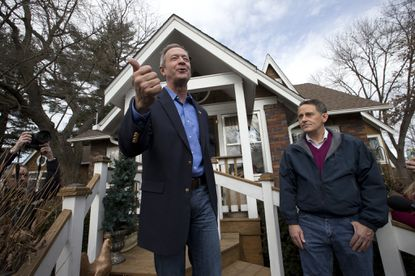 Democratic presidential candidate, former Maryland Gov. Martin O'Malley, left, is joined by Tom Henderson, Polk County Democratic party chair as he speaks to voters outside the home of Judy Anderson and Tom Leffler, Sunday, Jan. 31, 2016, in Johnston, Iowa. (AP Photo/Mary Altaffer) ORG XMIT: OTKMA102