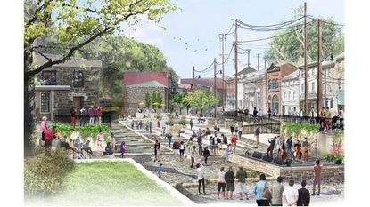 A plan to redevelop parts of central Ellicott City has been proposed by Howard County leaders. It would include removing some buildings, adding open space, a concert stage and a parking deck.