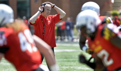 Maryland football coach DJ Durkin watches during the spring football game on April 16, 2016 in College Park.