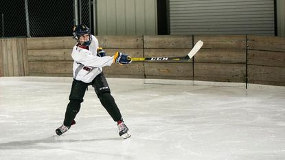 Finksburg resident Henry Lent is shown here playing club ice hockey. Henry, 13, died Aug. 18 while attending a youth clinic in southern Maryland.