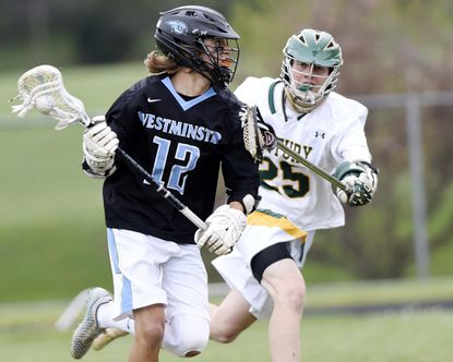 High School Notebook: Lax honors abound for Carroll