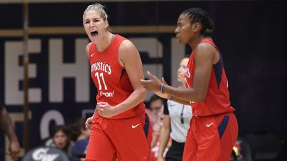 Washington Mystics forward Elena Delle Donne (11) gets pumped during the second half of Game 4 of a WNBA basketball playoffs semifinal series against the Atlanta Dream on Sunday, Sept. 2, 2018, in Washington. Delle Donne had 15 points and 10 rebounds. Ariel Atkins is at right.