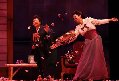 "Mika Shigematsu, left, as Suzuki and Asako Tamura as Butterfly in Lyric Opera Baltimore's production of ""Madama Butterfly"""