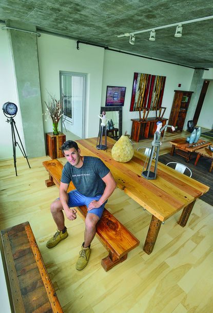 James Battaglia of Sandtown Millworks, where craftsmen create furniture made from reclaimed wood.