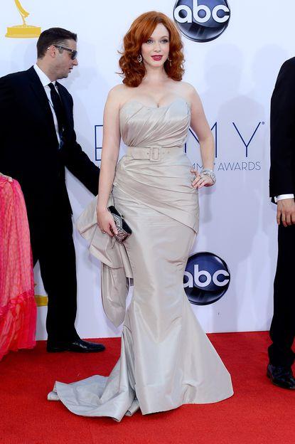 Christina Hendricks arrives at the Emmy Awards in an an ice gray custom silk taffeta gown from Siriano.