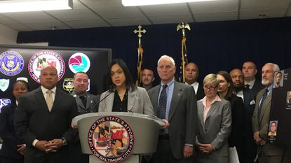 Baltimore State's Attorney Marilyn Mosby announces charges against 11 people for their ties to a South Baltimore drug distribution organization.
