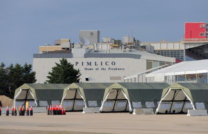 """Tents have been erected in a parking lot at Baltimore's Pimlico Race Course in anticipation of more frequent Coronavirus COVID-19 testing. Baltimore Mayor Bernard C. """"Jack"""" Young said the drive-thru testing center opens Friday."""