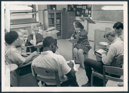 Florence Howe, center facing, sitting next to one of her Goucher undergraduates, conducts a class in poetry at Mergenthaler High School on June 16, 1968. The experimental program was an attempt to find literature that's relevant to students. Ellis J. Malashuk/The Sun